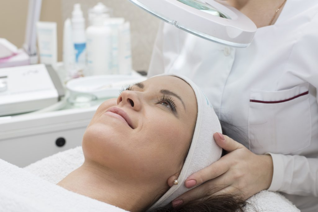 Image of Woman receiving cleansing therapy. Skin care